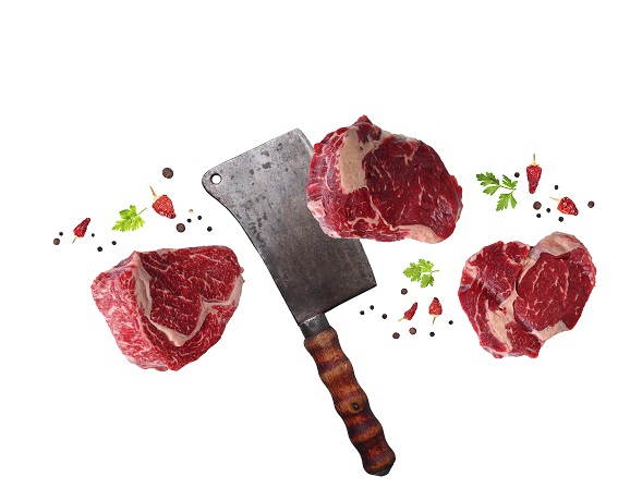 Raw marbled ribeye steak and butchers knife. Food levitation. Isolated on white